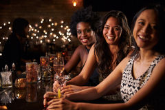 Portrait Of Female Friends On Night Out At Cocktail Bar Stock Image