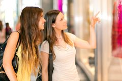 Portrait of female friends shopping together Stock Photos