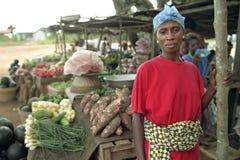 Portrait of female Ghanaian greengrocer on market. Ghana, central region, Effutu Municipal district, small town Winneba: close of Ghanaian woman selling fruit Stock Image