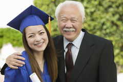 Portrait Of A Female Graduate And Grandfather Royalty Free Stock Images