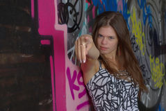 Portrait female and graffiti wall Royalty Free Stock Images