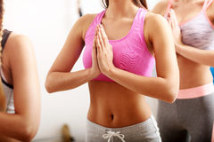 Portrait of female group practising yoga Stock Images