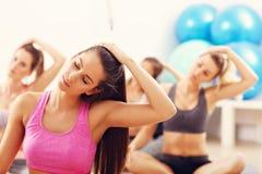 Portrait of female group practising yoga Stock Photo