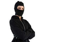 Portrait of female hacker standing with arms crossed. Against white background stock images