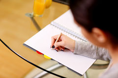 Portrait of a female hand writing notes Royalty Free Stock Photography
