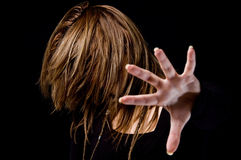 Portrait of female hiding her face with hair Royalty Free Stock Image