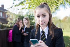 Portrait Of Female High School Student Wearing Uniform Being Bul royalty free stock photos