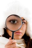 Portrait of female holding magnifing glass Royalty Free Stock Photos