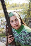 Portrait of a female hunter with a gun. In Siberia stock photos