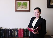 Portrait of a female lawyer at office. Reading a book royalty free stock photography