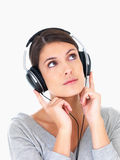 Portrait of a female listening to music on white Royalty Free Stock Photos