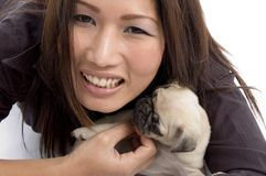 Portrait of female with little puppy Stock Images