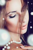 Portrait of female with lots of pearls Royalty Free Stock Photography