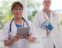 Portrait of female and male doctors Royalty Free Stock Photography