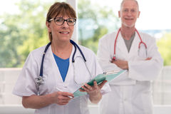 Portrait of female and male doctors Stock Photography