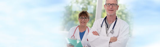 Portrait of female and male doctors Royalty Free Stock Photos