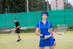 Portrait of female and male tennis players playing doubles outdo Royalty Free Stock Image
