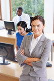 Portrait Of Female Manager In Busy Office. Smiling Stock Photography
