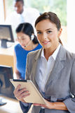 Portrait Of Female Manager With Digital Tablet In Office. Smiling Royalty Free Stock Photo