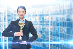 Portrait of female manager with golden cup stock photos