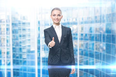 Portrait of female manager thumbing up Royalty Free Stock Image