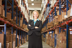 Portrait Of Female Manager In Warehouse. Looking to camera stock photos