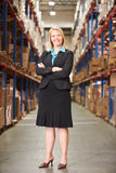 Portrait Of Female Manager In Warehouse. Looking to camera royalty free stock photography