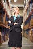 Portrait Of Female Manager In Warehouse. Looking to camera stock photography