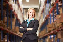 Portrait Of Female Manager In Warehouse. Smiling to camera stock photos