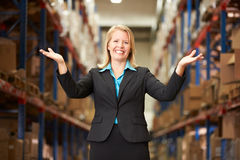 Portrait Of Female Manager In Warehouse. Smiling to camera royalty free stock image