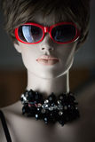 Portrait of a female mannequin. Portrait of the female dummy in a wig and glasses Stock Photo