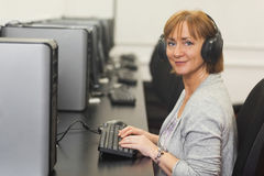 Portrait of female mature student working on computer Royalty Free Stock Photography