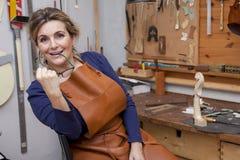 Portrait of female mature violin maker Stock Images