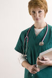 Portrait of female medical personnel. Wearing scrubs and stethoscope Stock Images