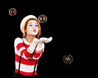 Portrait of the female MIM comedian catches bubbles, isolated on Stock Photos