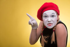 Portrait of female mime isolated on yellow Stock Photos