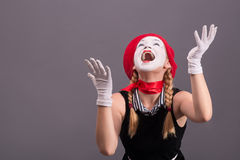 Portrait of female mime with red hat and white Stock Photo