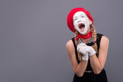 Portrait of female mime in red head and with white Royalty Free Stock Photos