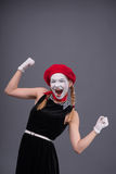 Portrait of female mime with white funny face Stock Image