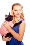 Portrait of a female mode holding black cat wearing pi Stock Photo