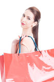Portrait of female model carrying shopping bags on shoulder Stock Photography