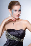 Portrait. Female model posing with face bejeweled with rhinestones Royalty Free Stock Images