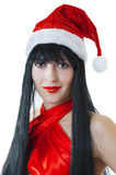 Portrait of female model in red santas cap Stock Photos