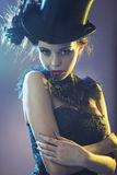 Portrait of the  female model with the top hat. Portrait of the alluring young female model with the black top hat Royalty Free Stock Images