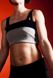 Portrait of female muscular torso. Portrait of athletic female with muscular torso Royalty Free Stock Photo