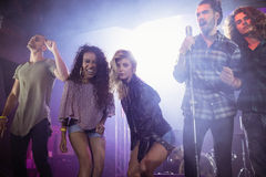 Portrait of female musicians with male performers at nightclub Stock Photo