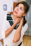 Portrait of female with neck and shoulders aching. Portrait of adult unhappy female with neck and shoulders aching royalty free stock photo