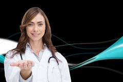 Portrait of female nurse holding out open palm Royalty Free Stock Photos