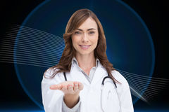 Portrait of female nurse holding out open palm Stock Image