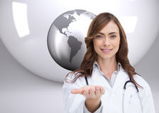 Portrait of female nurse holding out open palm Royalty Free Stock Photography